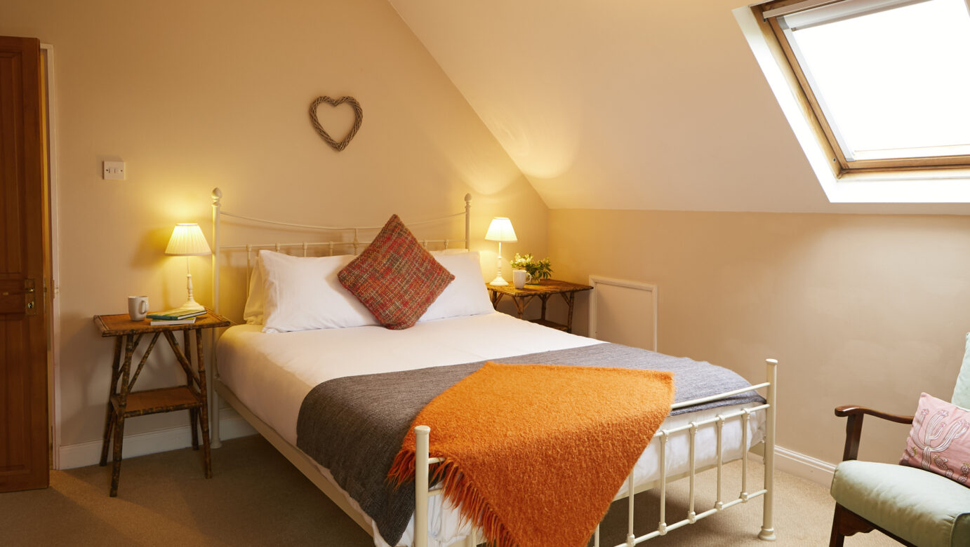 A single bed with skylight above