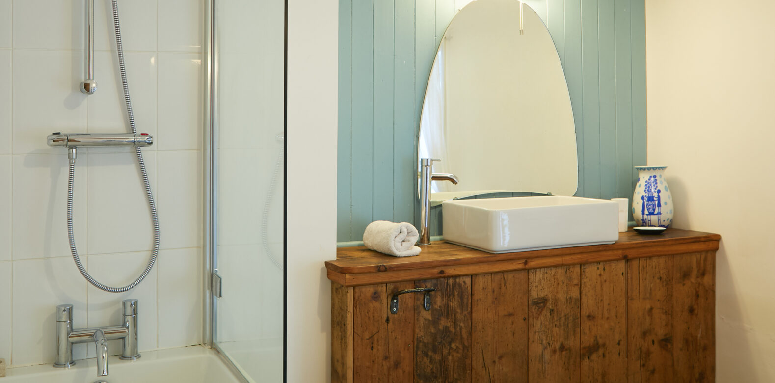 A bright bathroom sink and shower