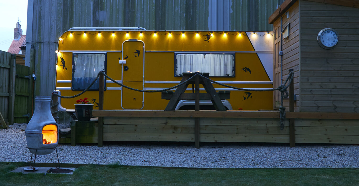 The big yellow caravan at night