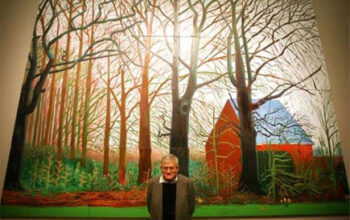 Man standing in front of large painting