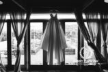 Brides dress hanging in the Summer house