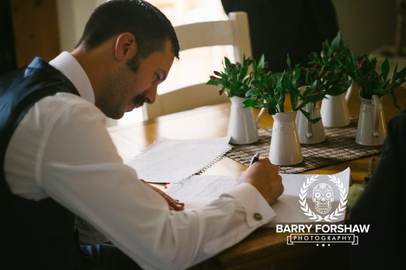 Man in waistcoat writing