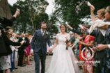 Bride and Groom showered by confetti