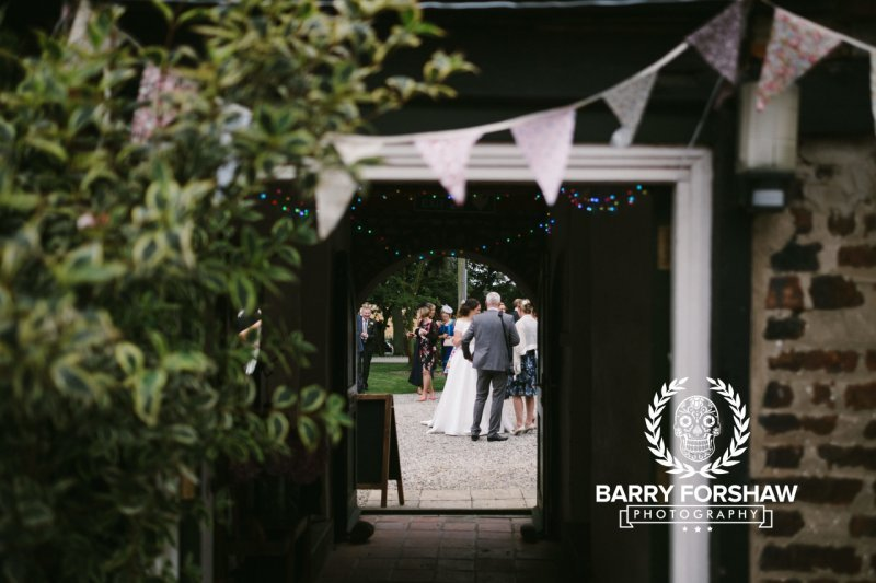 Wedding guests gather in courtyard