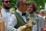 Wedding guest holding a small dog