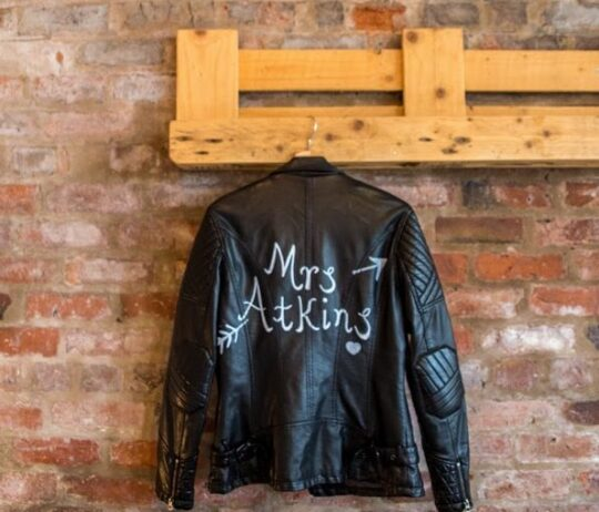 Mrs Atkins leather jacket hanging on the wall