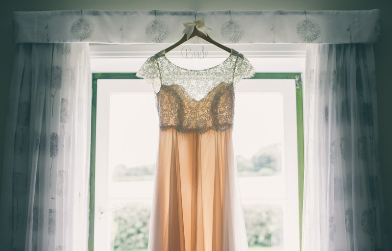 Wedding dress, hanging in the window