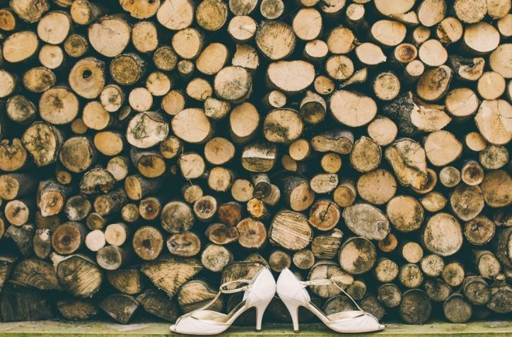 Log pile with high heels infront