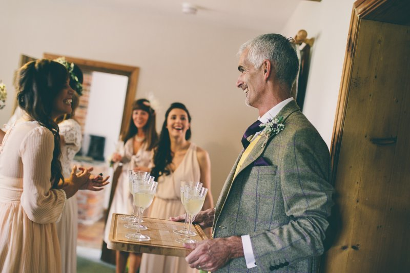 People laughing before a wedding