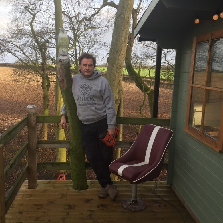 A man standing in the Dale Farm Tree House