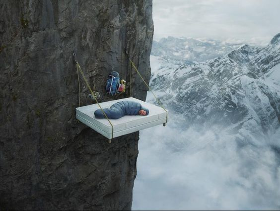Person sleeping on the side of a mountain