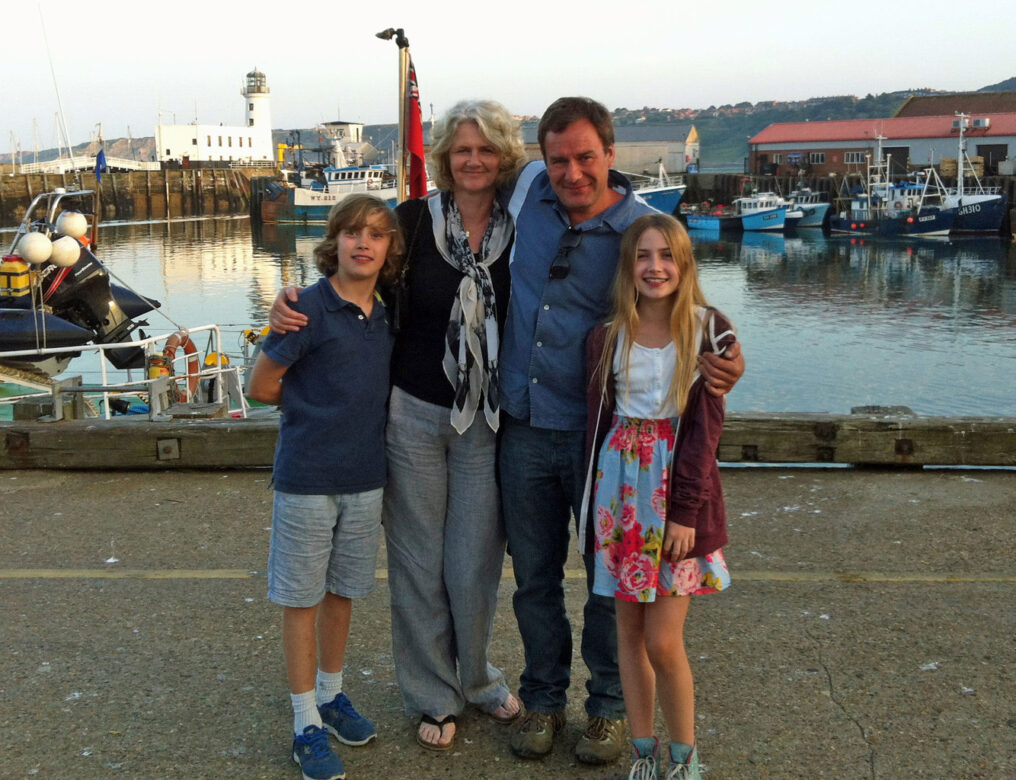 A family photo in a habour