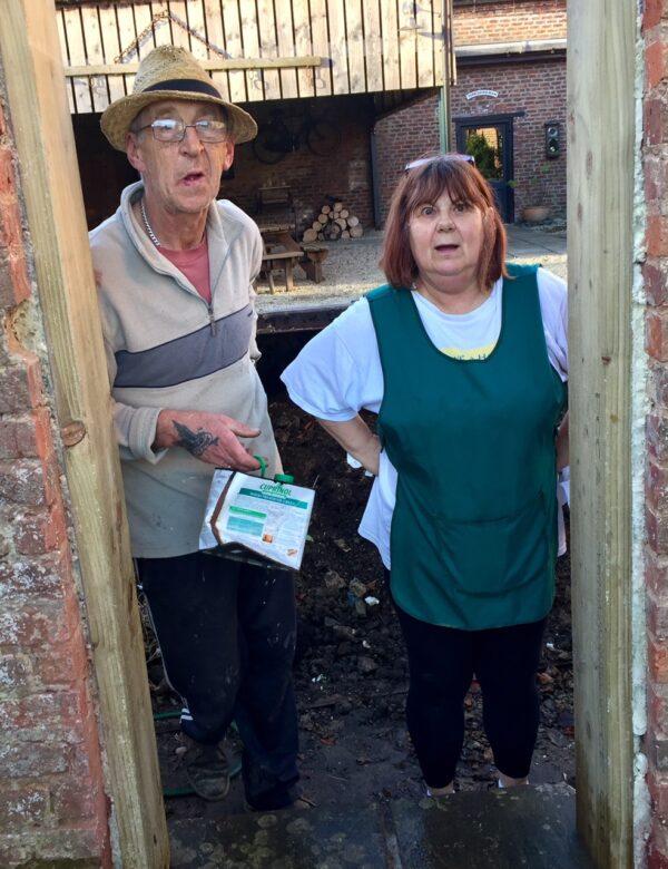 A couple standing in a doorway